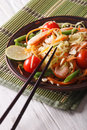 Papaya salad som tam with shrimp close up on a plate vertical the table Stock Photography
