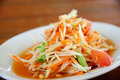 Papaya salad som tum spicy thai style food called Stock Photo