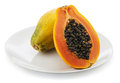 Papaya on white plate background Stock Photos