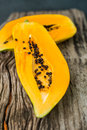 Papaya on the wooden board boards Stock Images