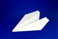 Paper airplane over blue background Royalty Free Stock Photos