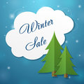 Paper applique fir tree and winter sale cloud on blue background Stock Photo