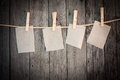 Paper attach to rope with clothes pins on wooden background Stock Photo