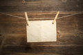 Paper attach to rope with clothes pins on wooden background Stock Photography