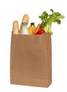 Paper bag with food over white on a background Royalty Free Stock Photography