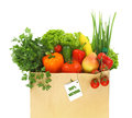 Paper bag full with fruits and vegetables Royalty Free Stock Photo