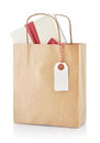 Paper bag with gift brown and tag isolated on a white background Royalty Free Stock Photo