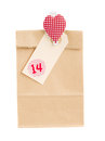 Paper bag with gift for valentines day isolated on white background Stock Photo