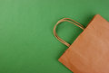 Paper bag on a green background Stock Photos