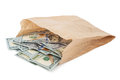 Paper bag with money Royalty Free Stock Photo