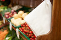Paper bags by fruit counter of farm shop near the Royalty Free Stock Image