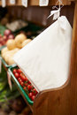 Paper bags by fruit counter of farm shop next to Stock Image