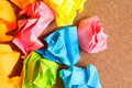 Paper ball crumpled of sticky post it note on craft paperboard Royalty Free Stock Photo