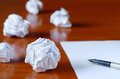 Paper balls and pen over blank white sheet creativity crisis concept Royalty Free Stock Image