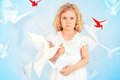 Paper birds beautiful little girl in her dream world surrounded with Stock Photo