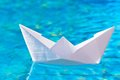 Paper boat in the pool on water Stock Images
