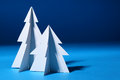 Paper christmas trees over blue background Royalty Free Stock Photography
