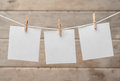 Paper on a clothespins sheets of wooden background space for text Stock Photography