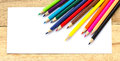 Paper and color pencils on table Royalty Free Stock Photo