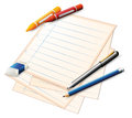 A paper with crayons and pencils Royalty Free Stock Photo