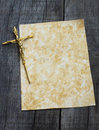 Paper with crucifix a stained a on wooden background Royalty Free Stock Photos