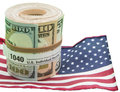 Paper currency roll form us flag isolated white the of banknotes held by a rubber band depicts the concept of irs income tax Stock Photos