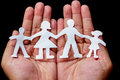 Paper cut family in the hands Royalty Free Stock Images
