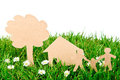 Paper cut of family with house and tree on grass. Royalty Free Stock Images