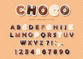 Paper cut out ABC letters and numbers, made of different kinds of chocolate on the wafer background. Royalty Free Stock Photo