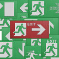 Paper cut of run to exit label for emergency with escape sign fr the from fire Stock Photos