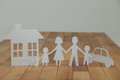 Paper Cutout Family With House...