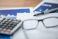 Paper document with business graph, pen, calculator and spectacles Royalty Free Stock Photo