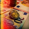 Paper euro banknotes and coins. The coin is two euros. Royalty Free Stock Photo
