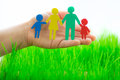 Paper family in hand over spring green grass ecology concept Royalty Free Stock Photos