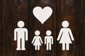 Paper family, parents and two clildren. Abstract conceptual image Royalty Free Stock Photo