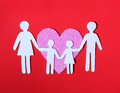 Paper family in pink heart over on red background love kids and concept Royalty Free Stock Photo