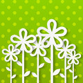 Paper flowers on green background Stock Photos