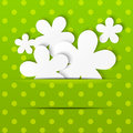 Paper flowers on green polka dot background Stock Images