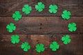 Paper green clover shamrock leaf border frame on dark wooden background Royalty Free Stock Photo