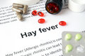 Paper with Hay fever  and pills. Royalty Free Stock Photo