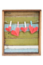 Paper heart hanging on the clothesline. On old wood background. Royalty Free Stock Images
