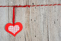 Paper heart hanging on clothesline on old wooden background Stock Images