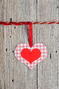 Paper heart hanging on clothesline on old wooden background Stock Image