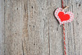 Paper heart hanging on rope on old wooden background Royalty Free Stock Photography