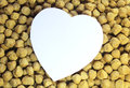 Paper heart in soya chunks texture background Stock Photography