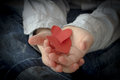 Paper Hearts in a kid's hand Royalty Free Stock Photo