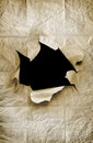 Paper hole old crumpled sheet with ripped in the center Royalty Free Stock Photo