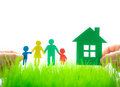 Paper house and family in hands Royalty Free Stock Photo