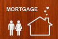 Paper house and family with mortgage text. Conceptual image Royalty Free Stock Photo