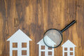 Paper house with Magnifying Glass, House hunting Royalty Free Stock Photo
